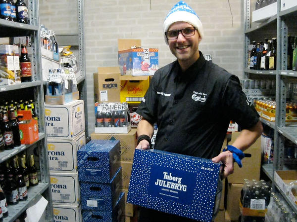 Jacob Lyby, a bar manager at Fox and Hounds in Herning, Denmark holding a case of the special Danish Christmas beer being released tonight in Denmark.