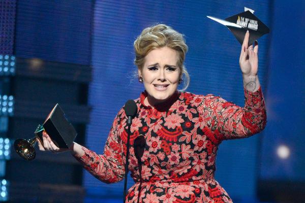 Adele accepts the Grammy for Best Pop Solo Performance for <em>Set Fire to the Rain</em> <em>(Live).</em>