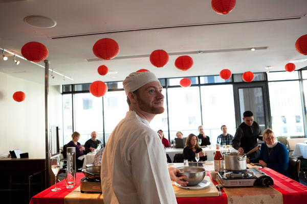 Chef Russell Blue Smith waits as Executive Chef Scott Drewno shouts out directions for teaching patrons to make Chinese dumplings the day before the beginning of the Chinese New Year, Feb. 9.