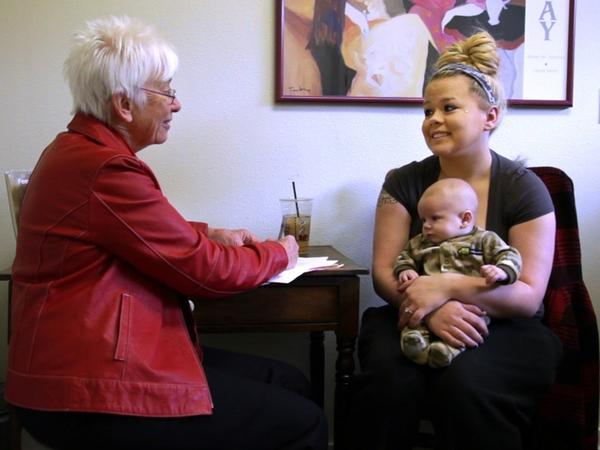 Colorado midwife Dian Sparling, 71, meets with Lisa Eldridge and her baby, Colton James.