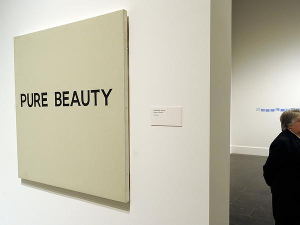 """""""Pure Beauty,"""" shown here at the Metropolitan Museum of Art in New York in 2010, is one of John Baldessari's many provocative """"text paintings."""""""