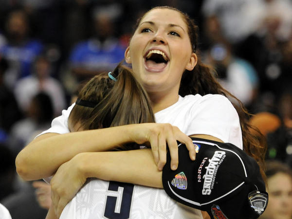 Connecticut center Stefanie Dolson hugs teammate Caroline Doty (No. 5) after the Huskies' win Monday night over Kentucky at Webster Bank Arena in Bridgeport, Conn.