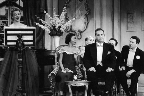 Caesar, flanked by cast performers Imogene Coca and Carl Reiner, listens to a singer in a skit from the TV comedy series <em>Your Show of Shows, </em>in 1952.