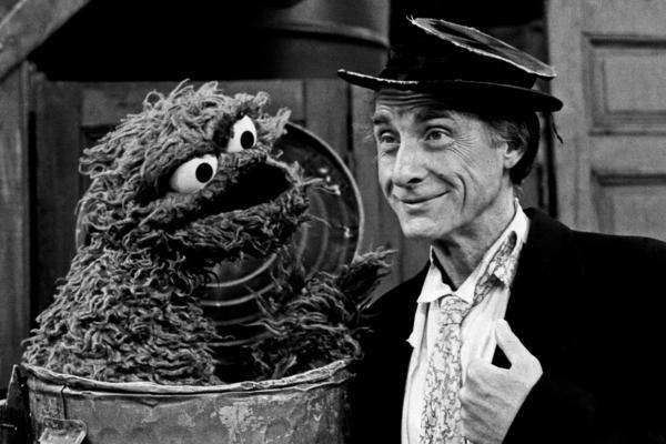 "Caesar portrays his classic ""professor"" in a guest appearance for <em>Sesame Street</em>'s 15th anniversary season in 1985."