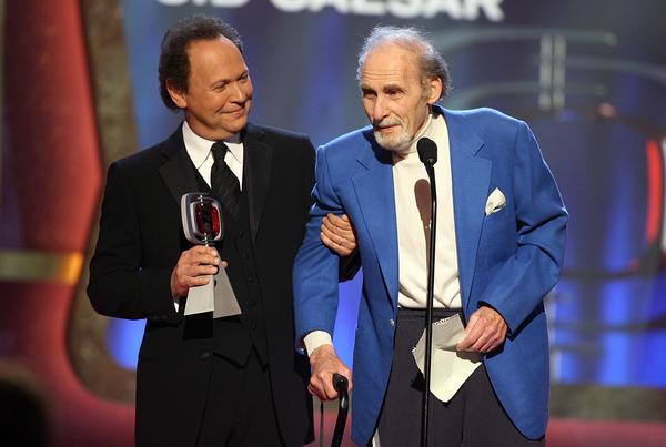 Actor Billy Crystal presents the Pioneer Award to Caesar onstage at the 2006 TV Land Awards, March 19, 2006, in Santa Monica, Calif.