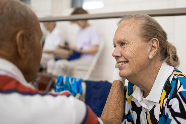 Janice Johnston sits with Graham after his races at the Cleveland State University Natatorium on Wednesday. She attends every one of his practices and races, cheering him on.