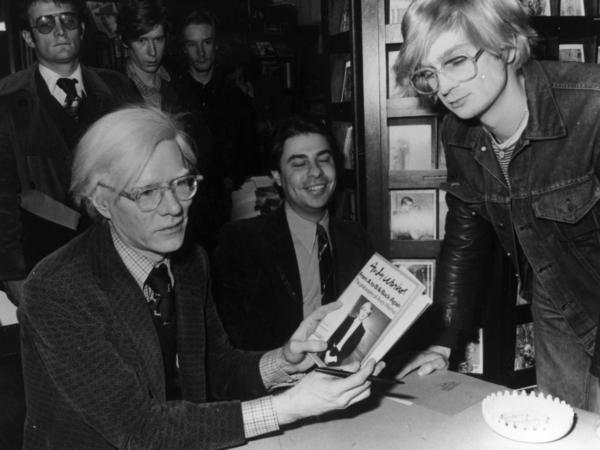 Artist Andy Warhol, seen here in 1975, was born 85 years ago today. The Pittsburgh museum named after the pop icon is hosting streaming video of his grave to mark the occasion.