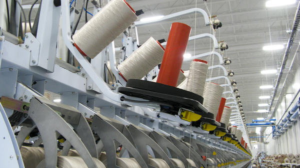 Fibers are rolled into spools at the Engineered Floors carpet plant in Dalton, Ga.