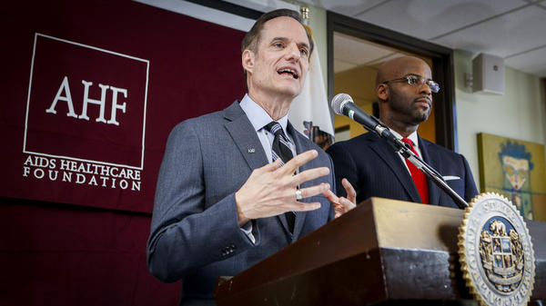Michael Weinstein of the AIDS Healthcare Foundation (left) at a press conference in February to introduce AB 332, a statewide bill to require condom use by adult film performers.