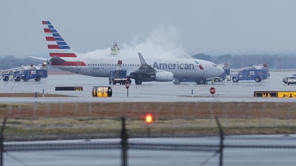 """Cleared for takeoff: That's the message from the """"new"""" American Airlines, after a bankruptcy judge ruled it could finalize its merger with US Airways Wednesday."""