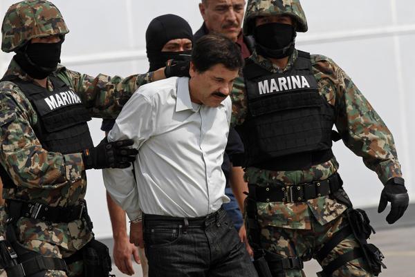 "Mexican Marines escort Joaquin ""El Chapo"" Guzman to a helicopter in Mexico City on Saturday."