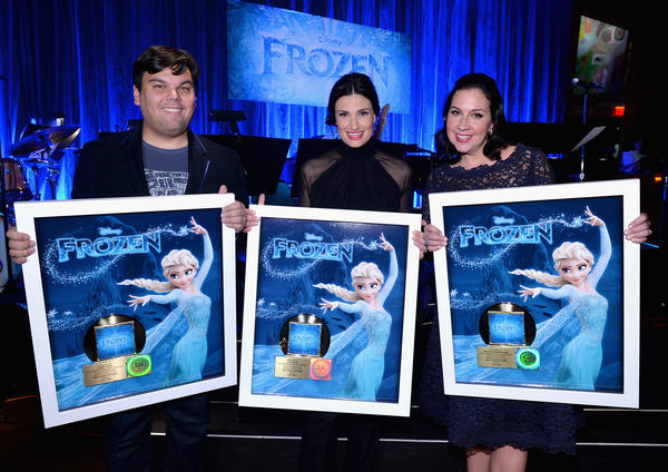 Singer Idina Menzel (center) and <em>Frozen</em> songwriters Bobby Lopez (left) and Kristen Anderson-Lopez pose with gold records in February. Since then, the movie's soundtrack has sold over 1.5 million more copies.