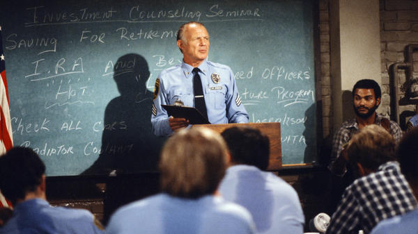 "Michael Conrad as Sgt. Phil Esterhaus does the cop roll call, concluding with his signature line: ""Let's be careful out there."""