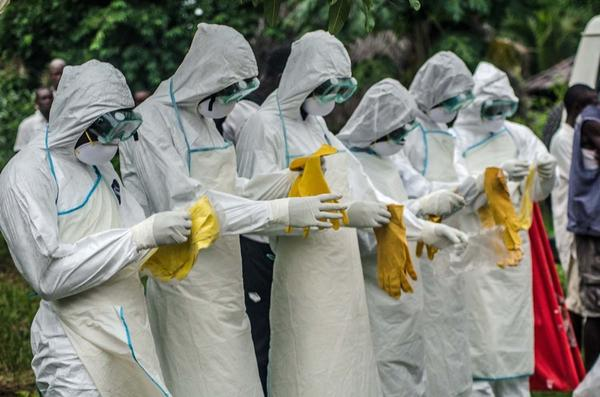Red Cross volunteers prepare to bury the body of an Ebola victim in Pendembu, Sierra Leone, early this month.