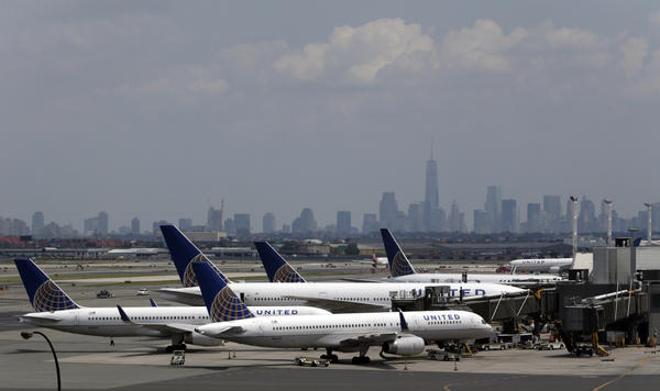 United Airlines jets are seen at the gate at Newark Liberty International Airport.