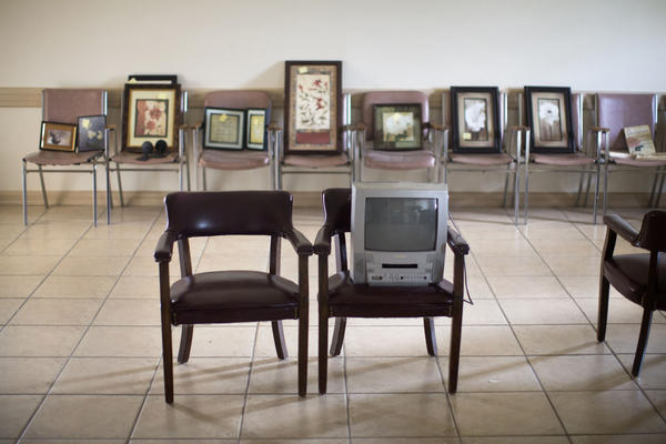 Artwork that once hung on the waiting room walls now sits in empty chairs. After he closed the clinic earlier this year, Minto and his staff packed up and sold much of the contents.