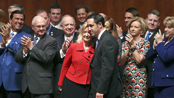 Bill sponsors Rep. Jodie Laubenberg and Sen. Glenn Hegar of Texas hug after Texas abortion restrictions are signed into law in July 2013.