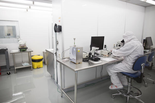 "An employee works in a clean room at Exelis. Mike Ognenovski, the company's vice president of operations, says he wants to make the work here ""more of a science versus an art."""