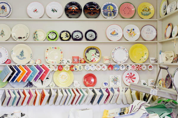 A variety of products and materials line a wall in the company's design department.