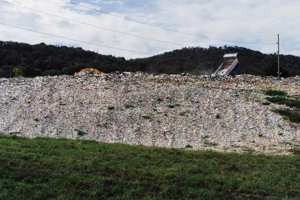 "A truck dumps broken and discarded pieces of ceramic onto what employees call ""Sparkle Mountain,"" located on the property of Homer Laughlin China Co. Some of the debris gets recycled."