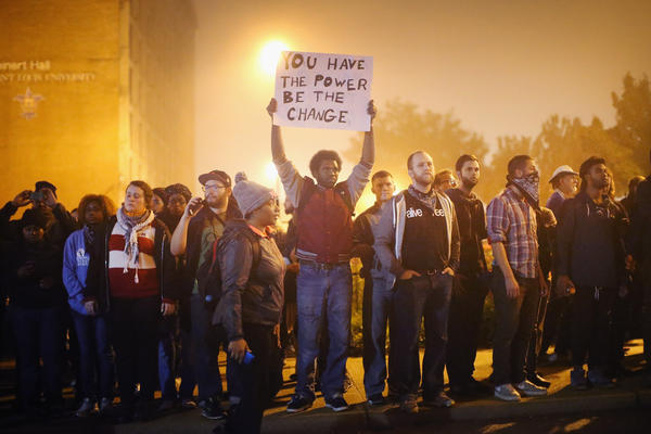 Demonstrators march through the street on Oct. 13 in St Louis, Mo. The St. Louis area has been struggling to heal since riots erupted following the Aug. 9 killing of 18-year-old Michael Brown by a police officer in suburban Ferguson. Another teenager, Vonderrit Myers Jr., was killed by a St. Louis police officer on Oct. 8.