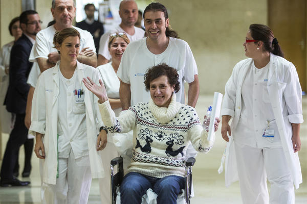 Teresa Romero Ramos, bottom right, arrives with medical workers to give a press statement before she leaves the Carlos III hospital in Madrid, Spain on Wednesday.