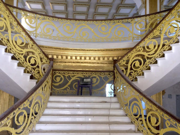 The banister of the grand staircase inside the Kurdish version of the White House is covered in 21-karat gold leaf.