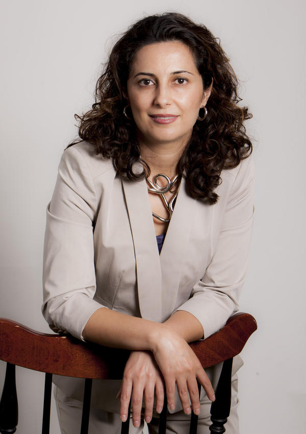 Nazila Fathi reported from her native Iran for <em>The New York Times.</em> Fearing arrest, she fled in 2009 with her family and now lives in suburban Washington, D.C. Her new book, <em>The Lonely War,</em> describes the challenges of reporting from the country.
