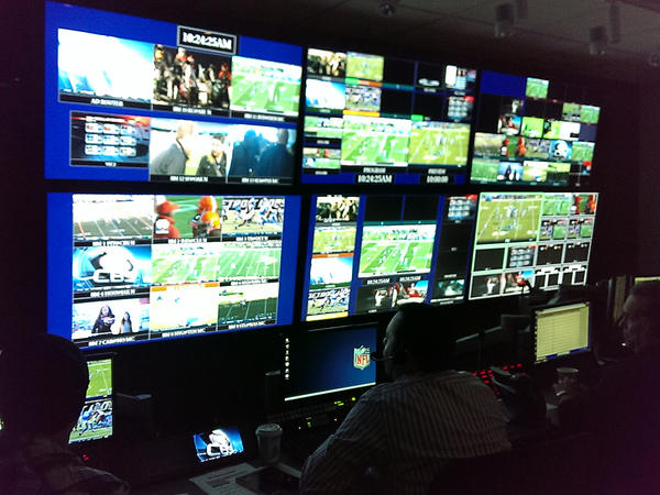 Inside the control room, dozens of monitors allow the production team to keep an eye on the live games and the available replays and graphics.