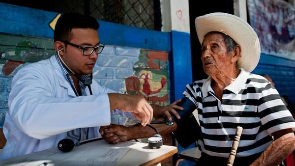 A doctor examines a patient during a June campaign to find chikungunya cases in the town of Ayutuxtepeque, El Salvador. The country reported more than 100,000 cases of chikungunya in 2014.