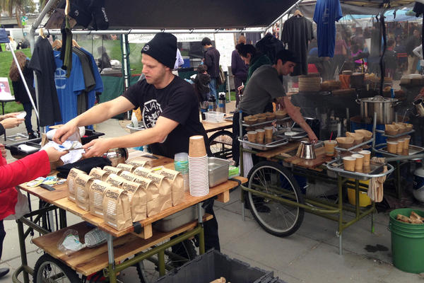 Bicycle Coffee serves its brews at the Grand Lake Farmers Market in Oakland, Calif.
