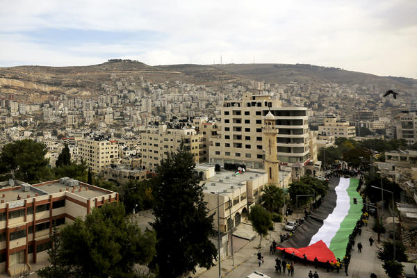 Palestinians held rallies last November, like this one in the West Bank city of Nablus, to mark the 10th anniversary of the 2004 death of Yasser Arafat. Palestinians are increasingly frustrated with the two decades of on-and-off peace talks that have not led to an independent Palestinian state.