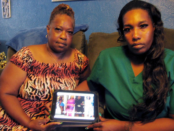 Algarene Jennings (left) and Kawana Walker, aunt and sister, respectively, of Latandra Ellington, who died while an inmate in a central Florida prison. A state autopsy said she died of natural causes, but her family says she was threatened by a guard before her death.