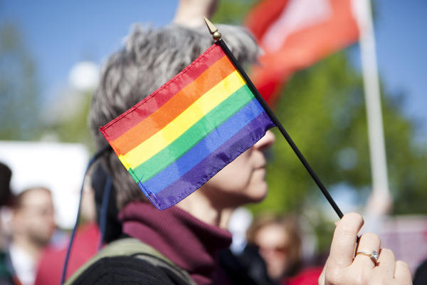 Sue Wedda from Boston holds a flag outside of the Supreme Court on Tuesday.
