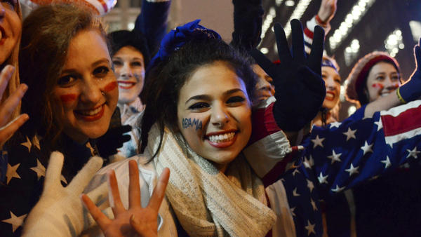 Young women celebrate election results in 2012.