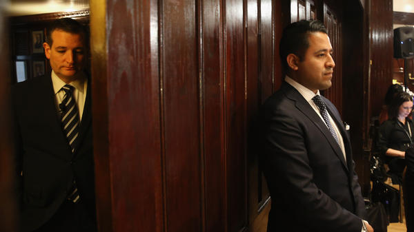 Ted Cruz (left) waits offstage Wednesday in Washington, D.C., as he is introduced to speak to the Hispanic Chamber of Commerce.
