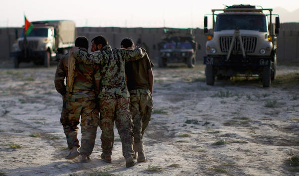 Afghan soldiers return to Camp Eagle after a patrol in Shah Joy district.