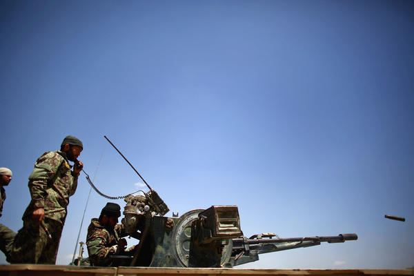 Afghan soldiers shoot at suspected Taliban members in Tazir Abad and the parched hills beyond. <br /><br />
