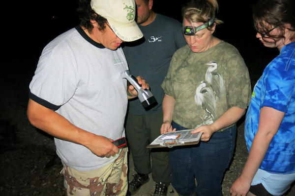 Jim Hewes, volunteer leader of the counting teams; Debbie Sullivan, volunteer counter; and her daughter Laurel Sullivan record their crab count on paper.