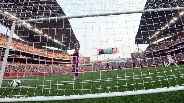 Australian goalkeeper Melissa Barbieri, left, looks at the ball after U.S. midfielder Megan Rapinoe, right, scored a goal Monday night in the teams' first game of the Women's World Cup.