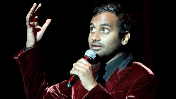 Comedian Aziz Ansari, seen here performing a show last year, has written a book about love — and what people really want.