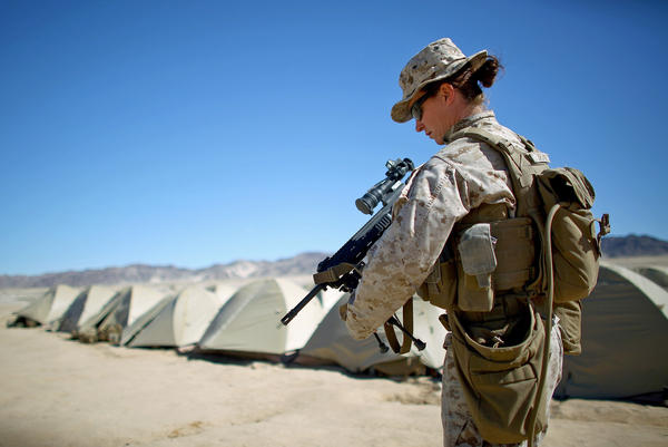 Sgt. Kelly Brown puts her weapon over her shoulder at the Marine base at Twentynine Palms, Calif. in March.