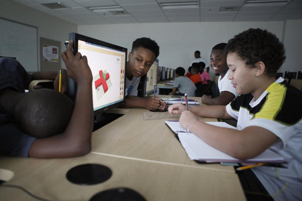 Middle-school boys participate in the Minority Male Makers summer program at Morgan State University in Baltimore.