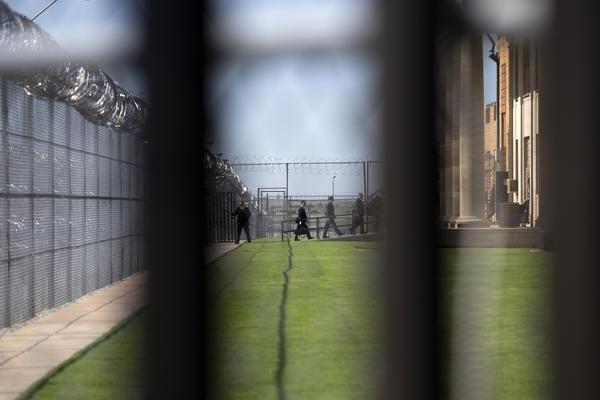 White House staff walk into the El Reno Federal Correctional Institution in El Reno, Okla.