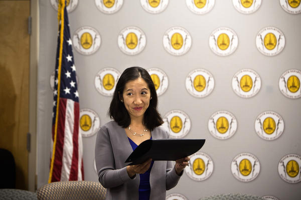 Leana Wen hands out awards to business owners for their efforts to support breastfeeding at the Baltimore City Health Department on Tuesday.