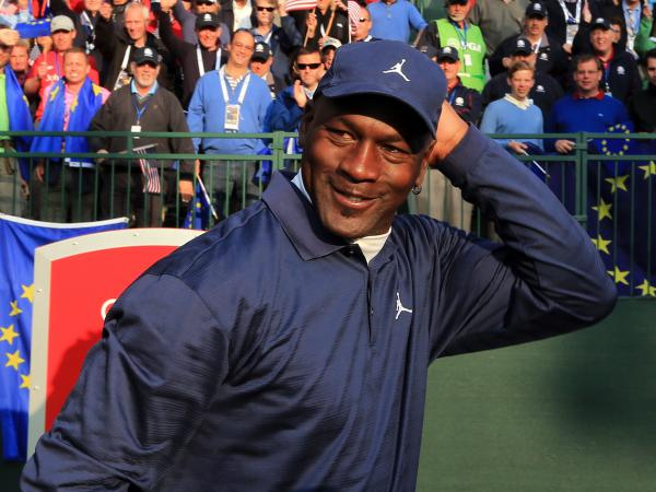 An on-brand Michael Jordan at the 2012 Ryder Cup, a few months after he sued Qiaodan Sports for the first time.