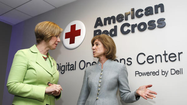 American Red Cross chief Gail McGovern (right) and Rep. Susan Brooks of Indiana tour the American Red Cross Digital Operations Center last year in Washington, D.C.