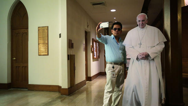 A visitor takes a selfie with a cardboard cutout of Pope Francis at St. Patrick's Catholic Church in Washington, D.C., on Sept. 16.