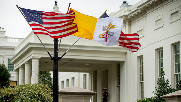 The Flag of Vatican City flies next to American flags outside the West Wing of the White House on Monday ahead of Pope Francis' arrival.