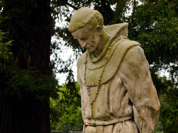 A statue of Father Junipero Serra stands in the cemetery of the historic Mission Dolores in San Francisco.